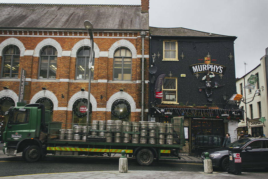 irish pub being stocked up with kegs.