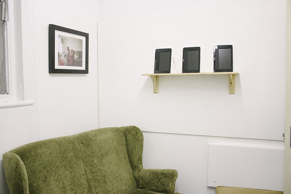those dvd players on the wall there housed three rotating portraits, 360 degree views of each person.